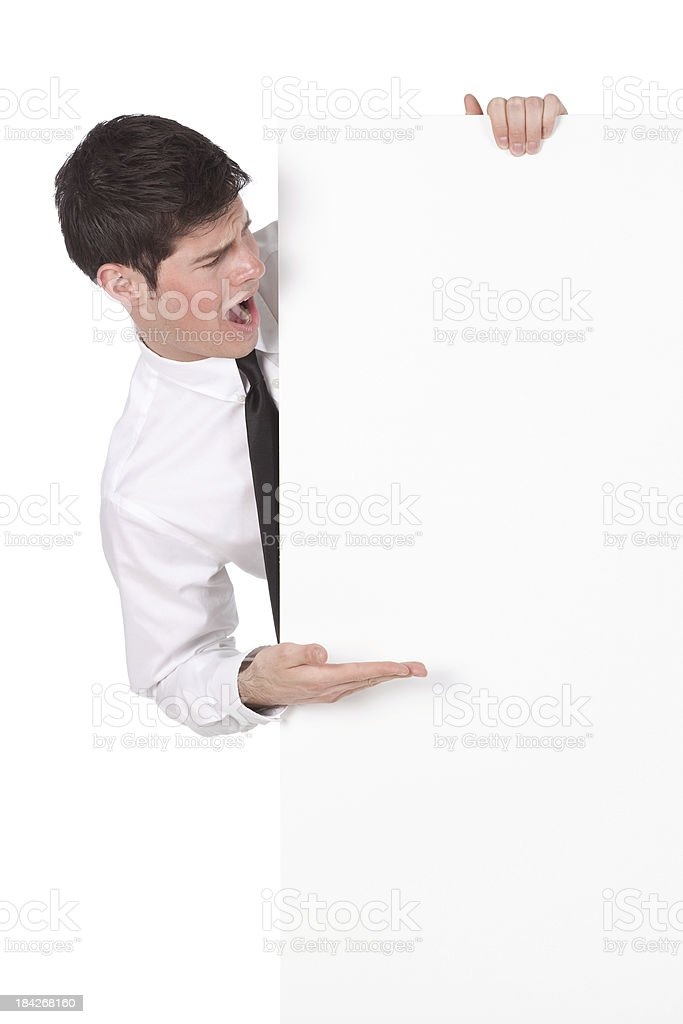Surprised businessman looking at a placard royalty-free stock photo