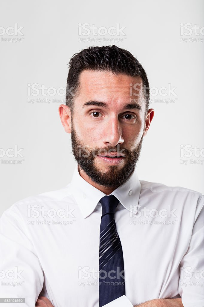 surprised businessman with his arms folded stock photo