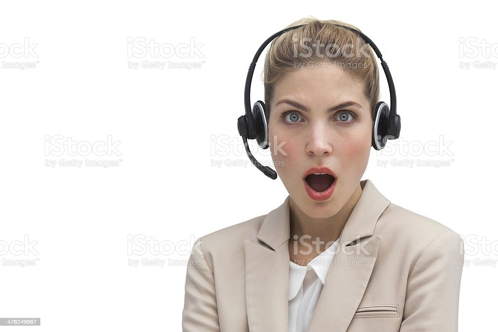 Surprised call center agent with mouth open royalty-free stock photo