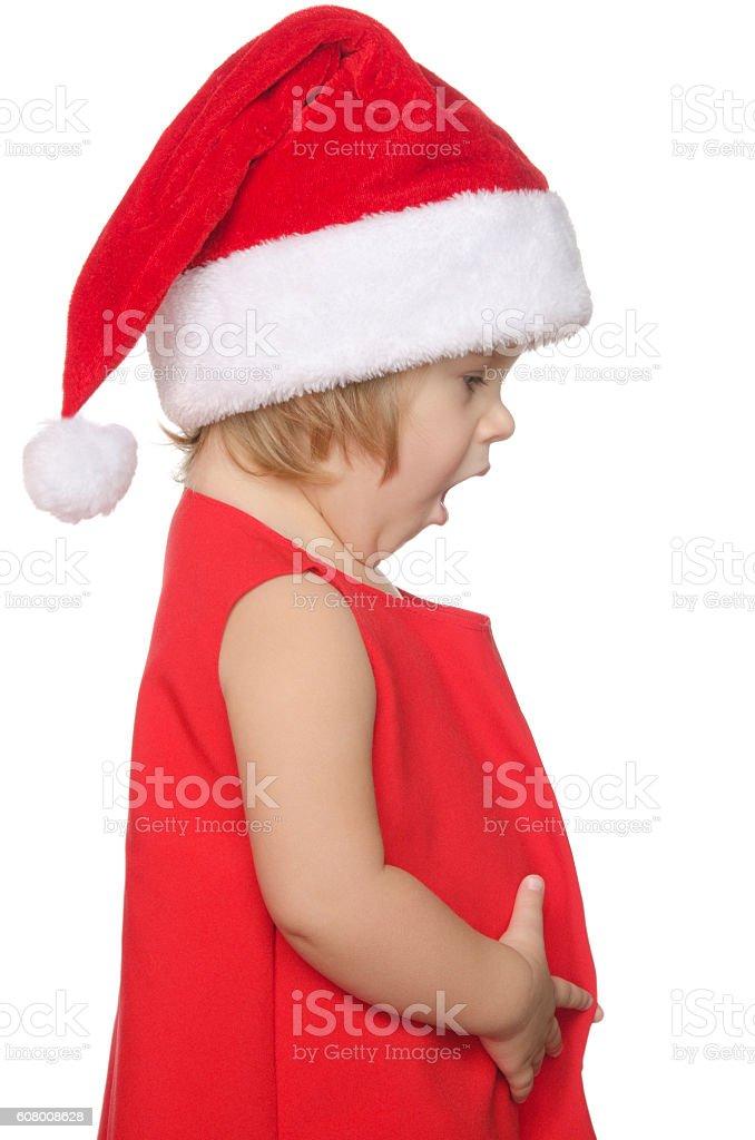 surprised child in christmas cap stock photo