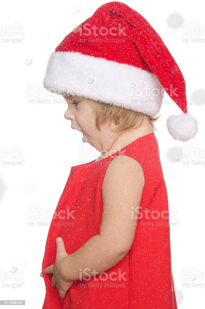 surprised child in christmas cap, snow stock photo