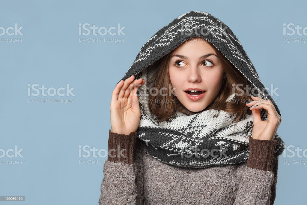 Surprised christmas girl wearing knitted wear scarf. winter concept stock photo