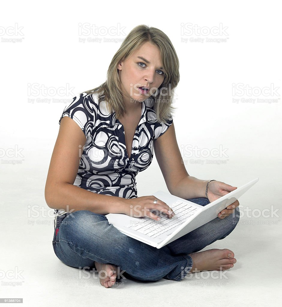 surprised computing girl sitting in light back royalty-free stock photo