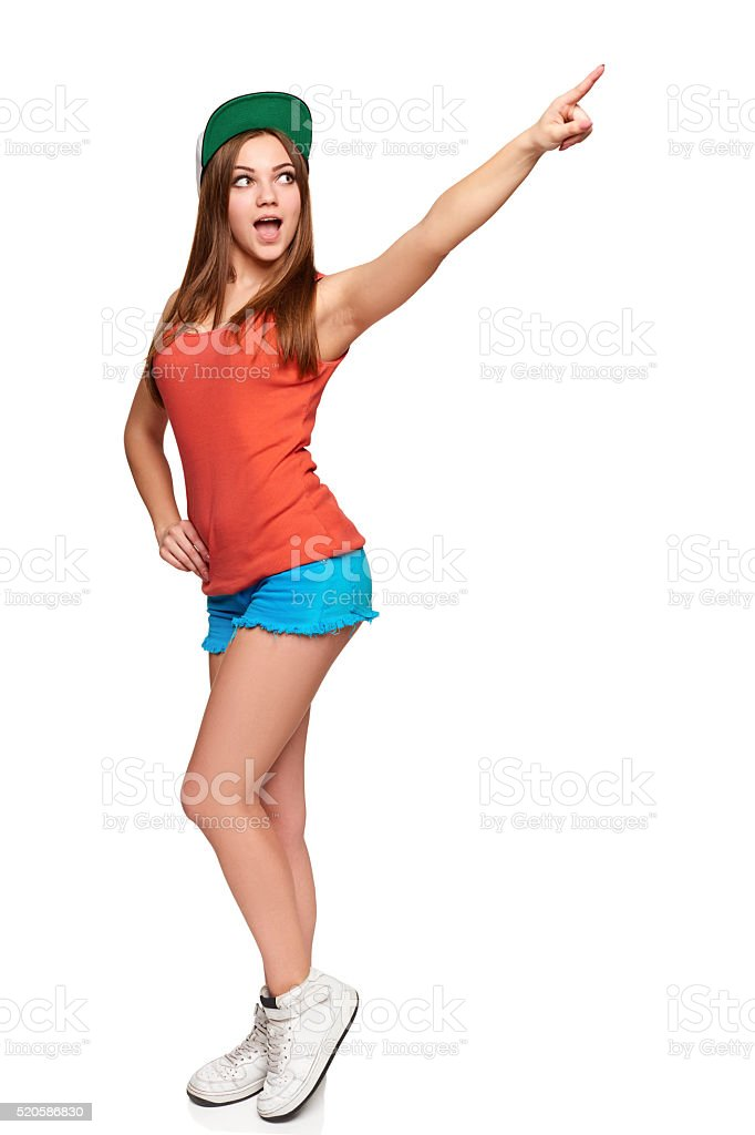 Surprised female pointing at copy space stock photo