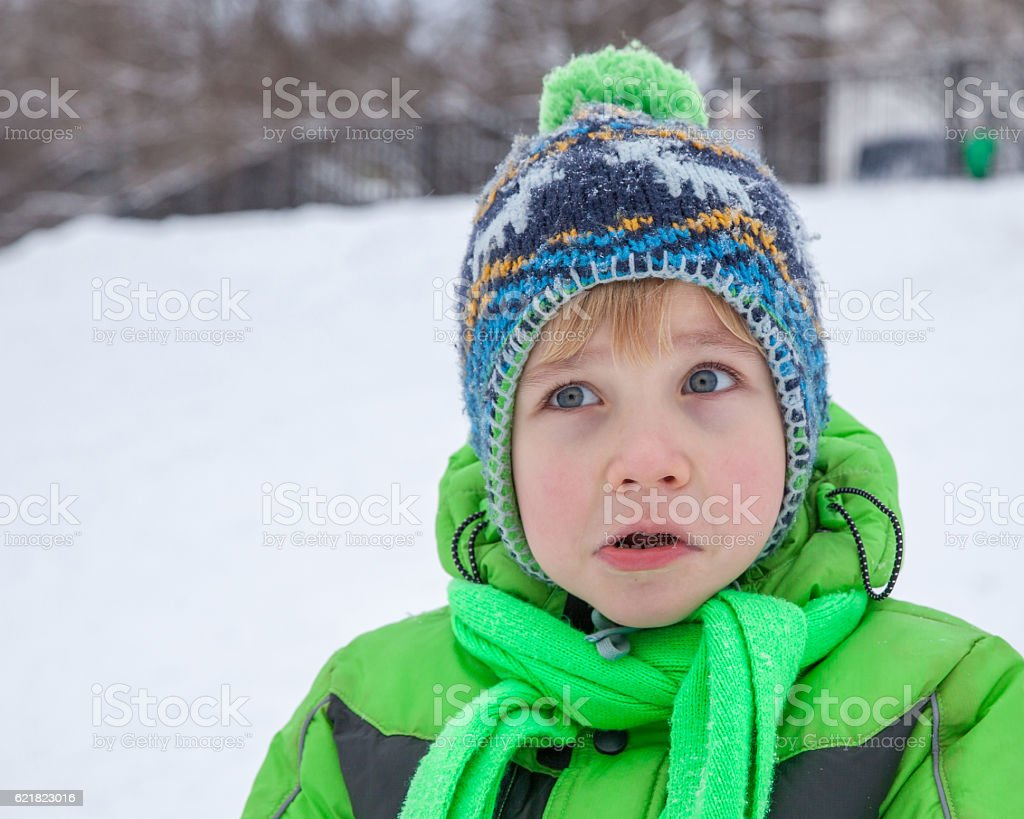 Surprised five years old boy stock photo