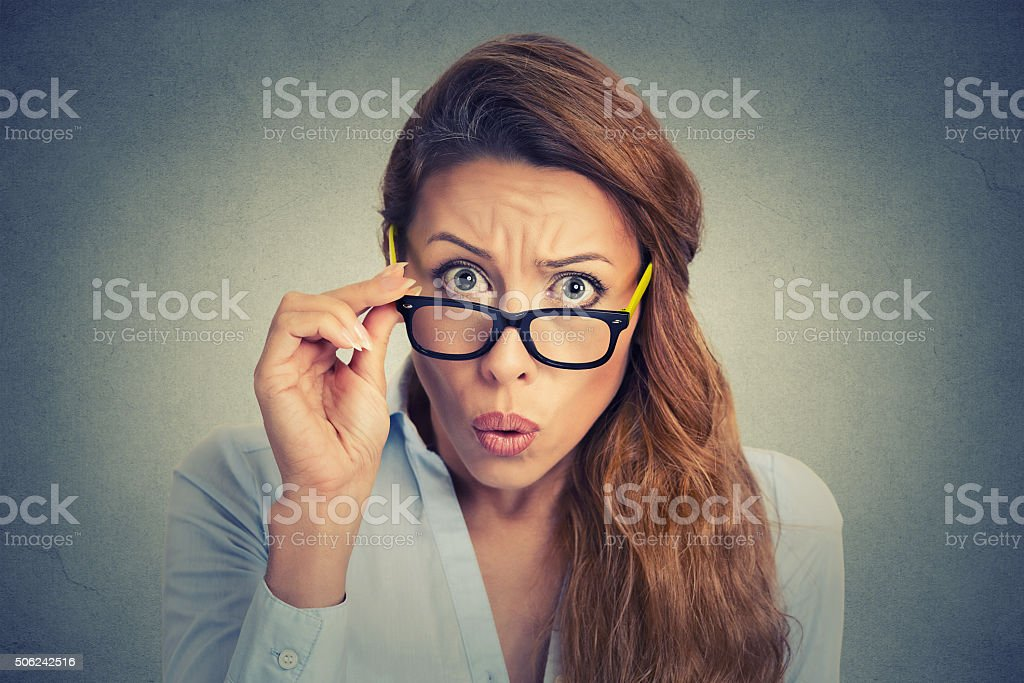 Surprised frustrated young woman stock photo