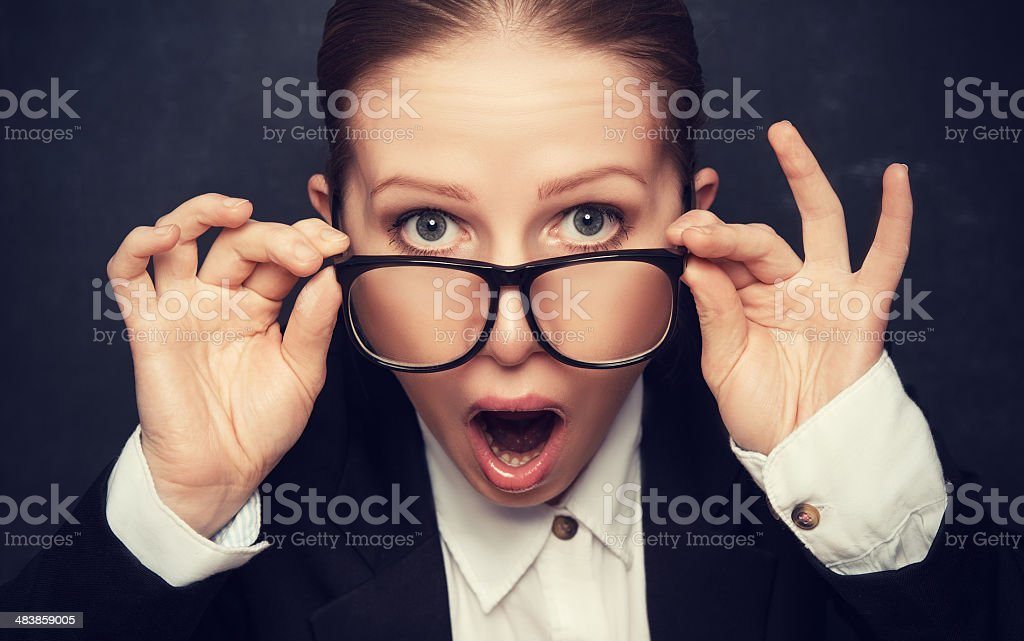 Surprised funny teacher in glasses shouts royalty-free stock photo
