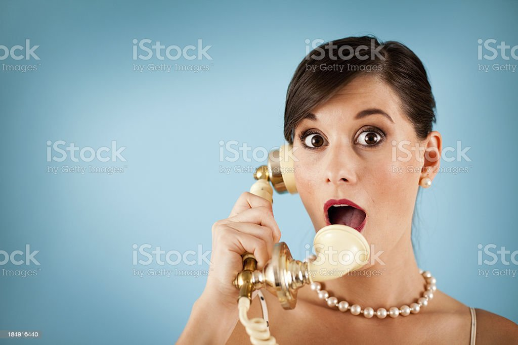 Surprised Gal Holding Vintage Phone royalty-free stock photo