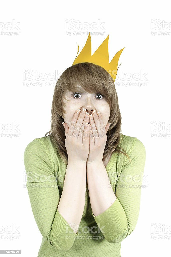 Surprised girl in a crown royalty-free stock photo