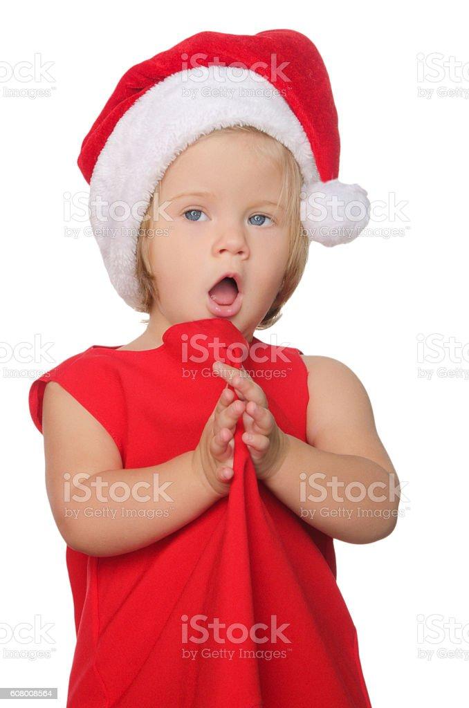 surprised girl in christmas cap stock photo