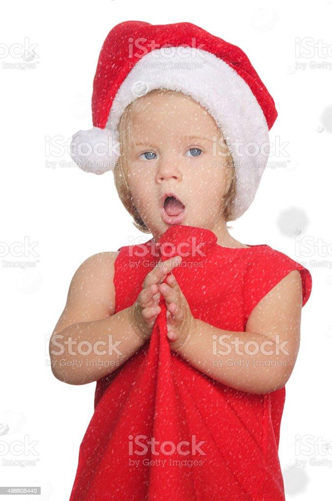 surprised girl in christmas cap, snow stock photo