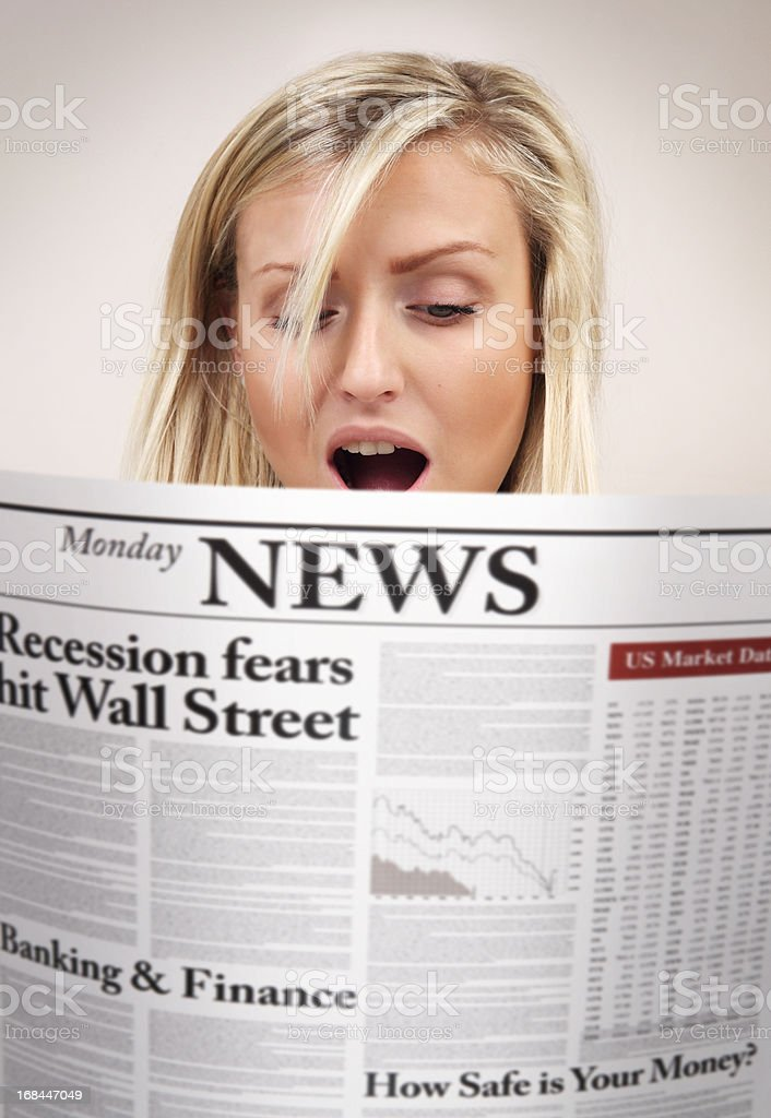 Surprised girl reading newspaper with bad economic news royalty-free stock photo