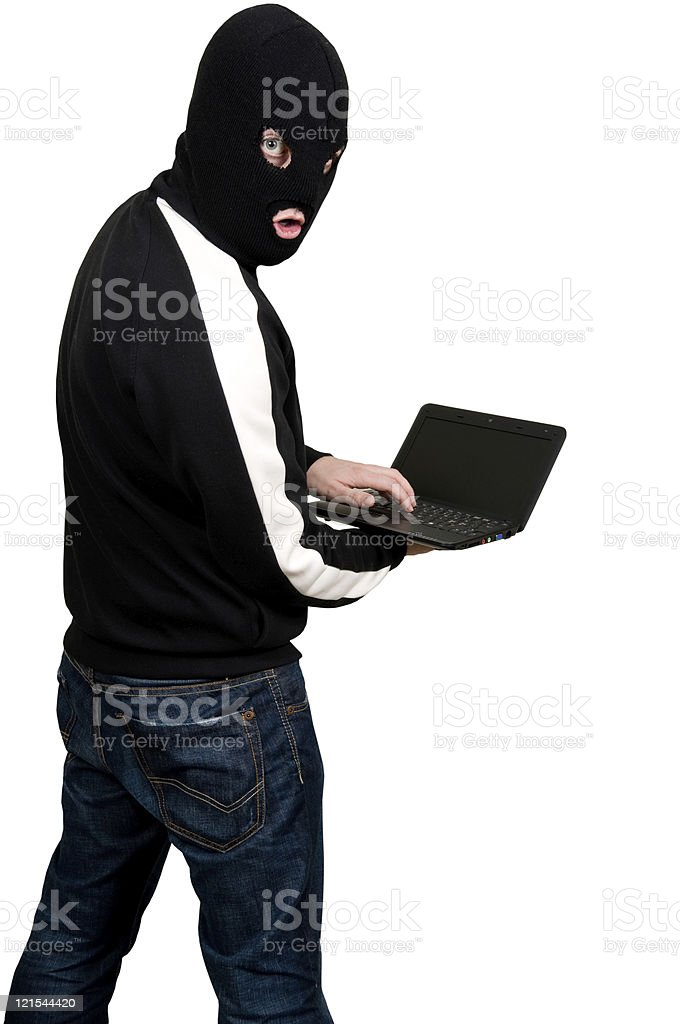 Surprised hacker is caught by the camera while working royalty-free stock photo