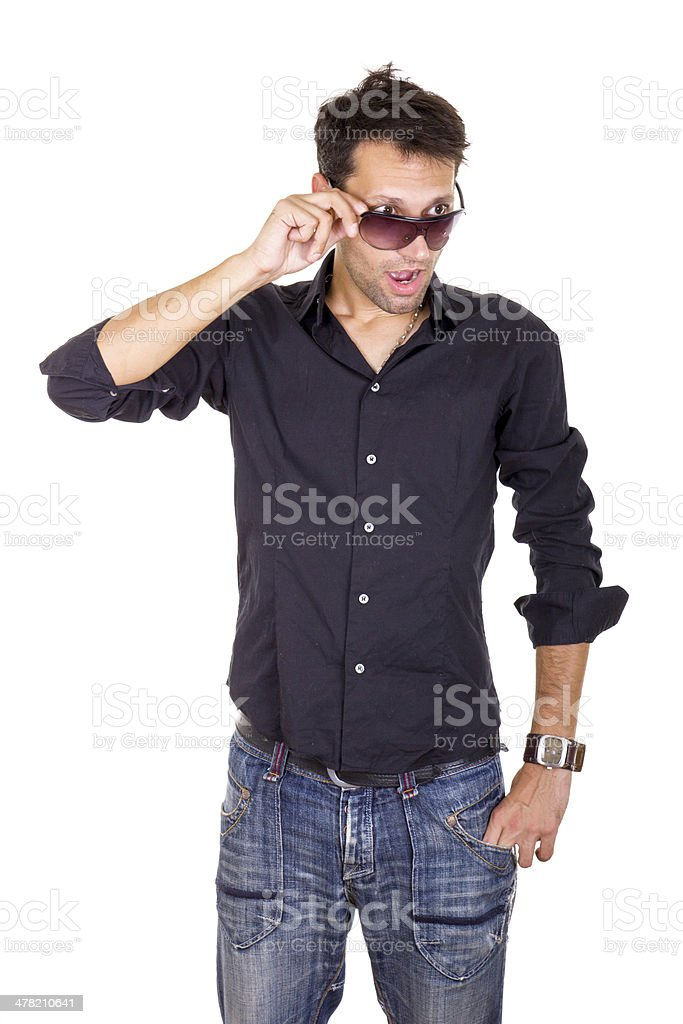 surprised handsome man looking under sunglasses making eye conta stock photo