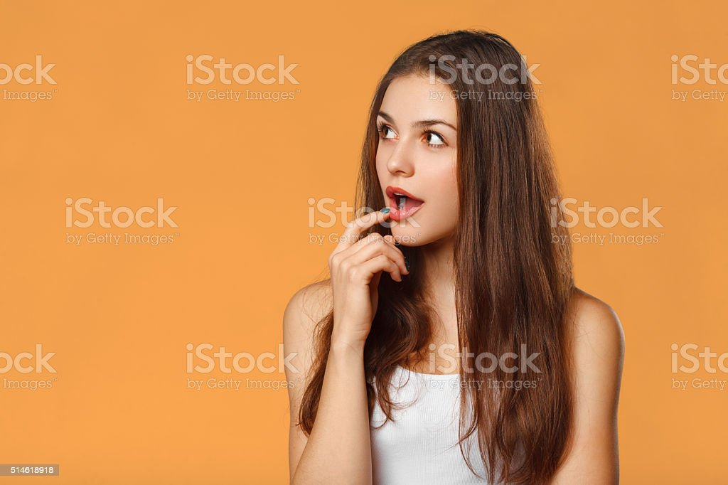 Surprised happy beautiful woman looking sideways in excitement, isolated stock photo