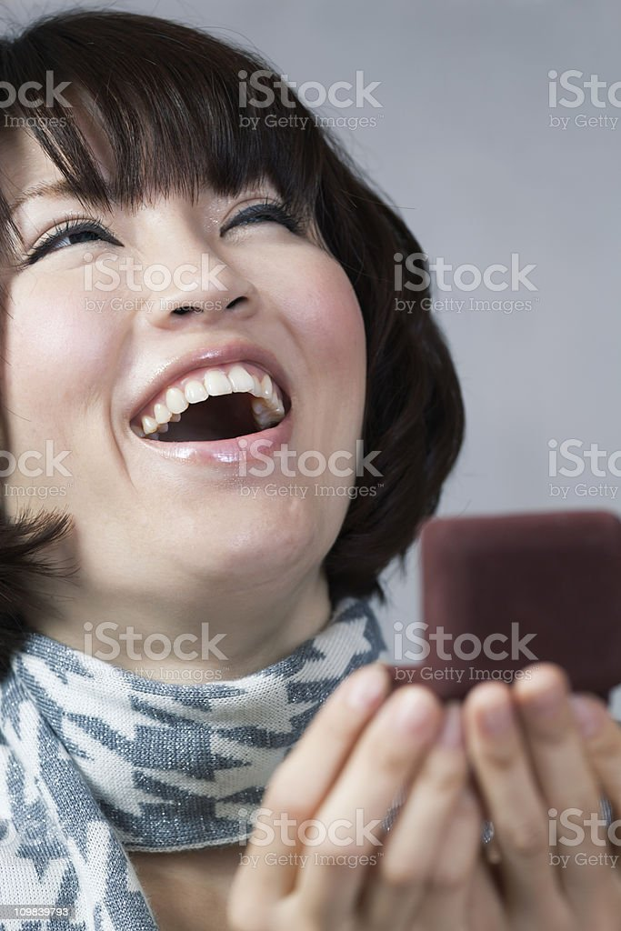 Surprised, Happy Young Asian Woman Receiving a Jewelry Box Gift royalty-free stock photo