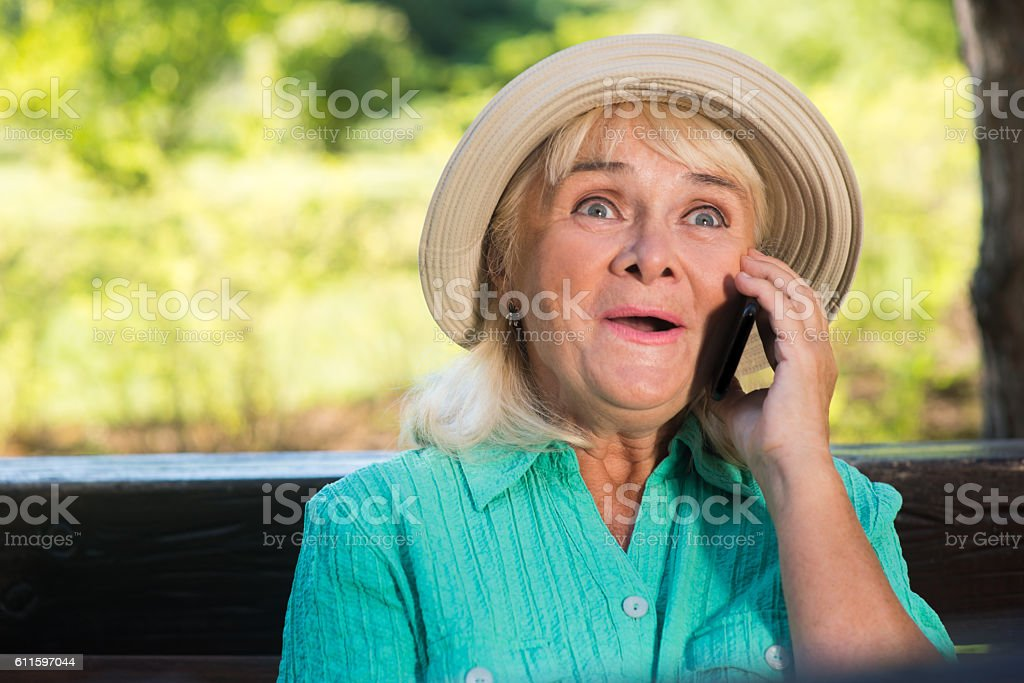 Surprised lady with a phone. stock photo