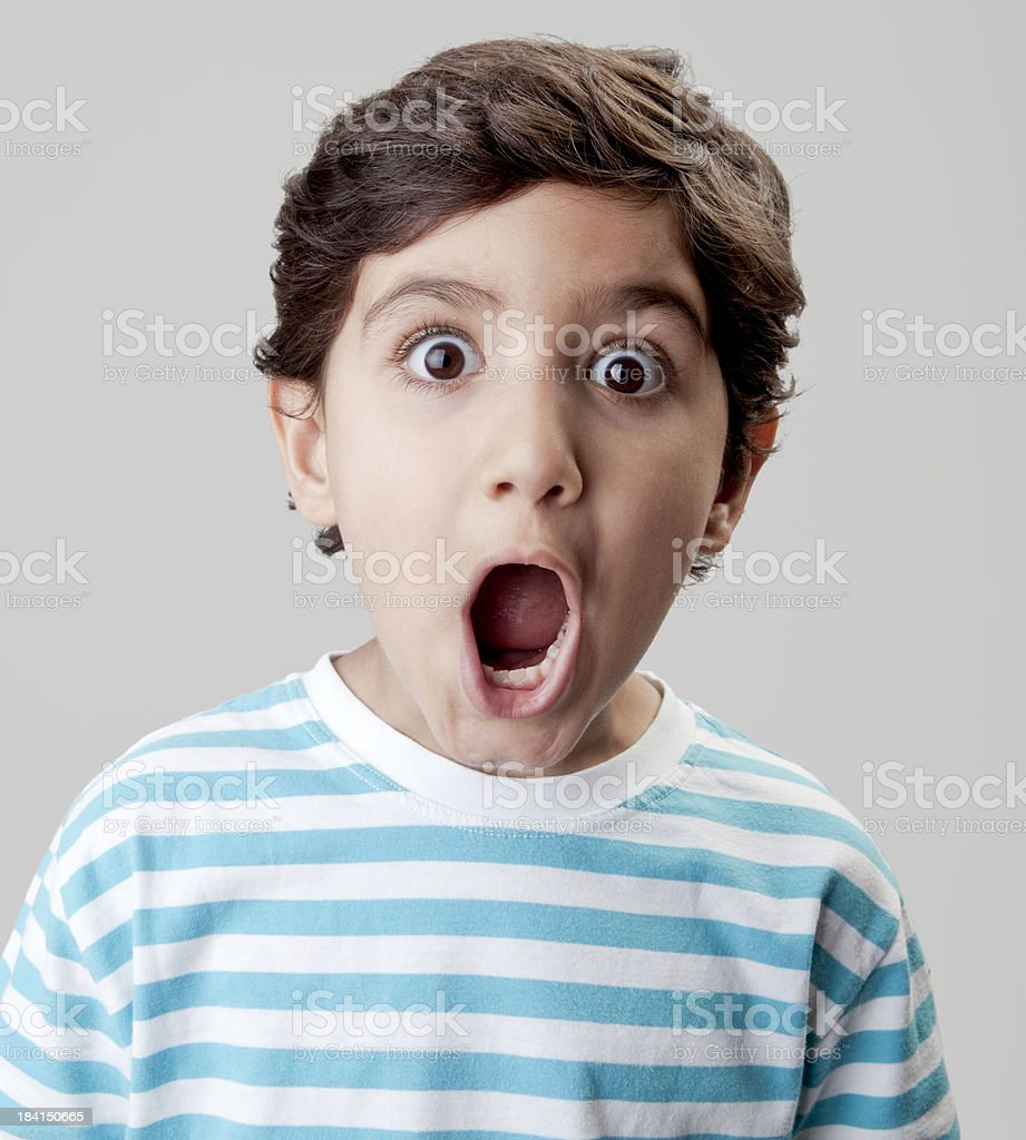 Surprised little boy stock photo