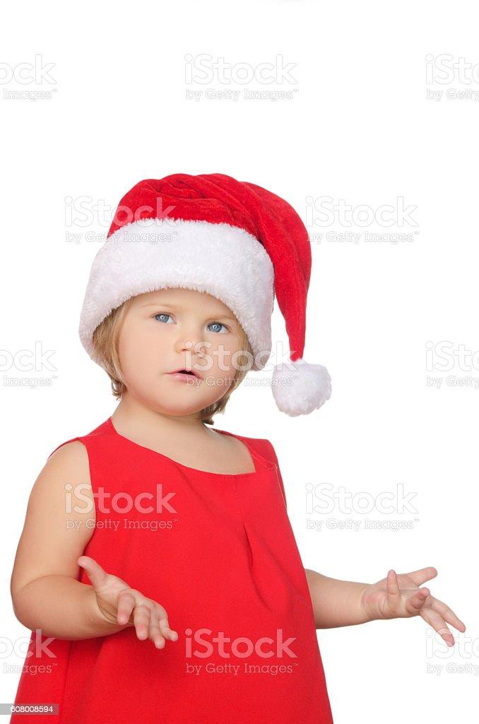 surprised little girl in christmas cap stock photo