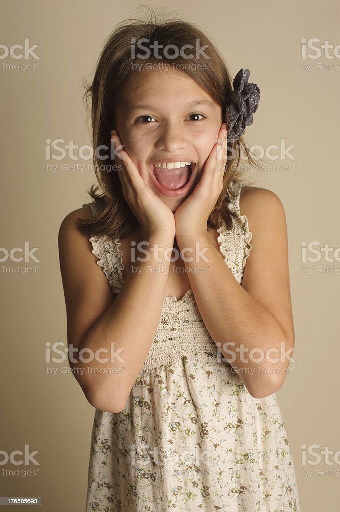 Surprised Little Girl Standing With Flower in Hair royalty-free stock photo