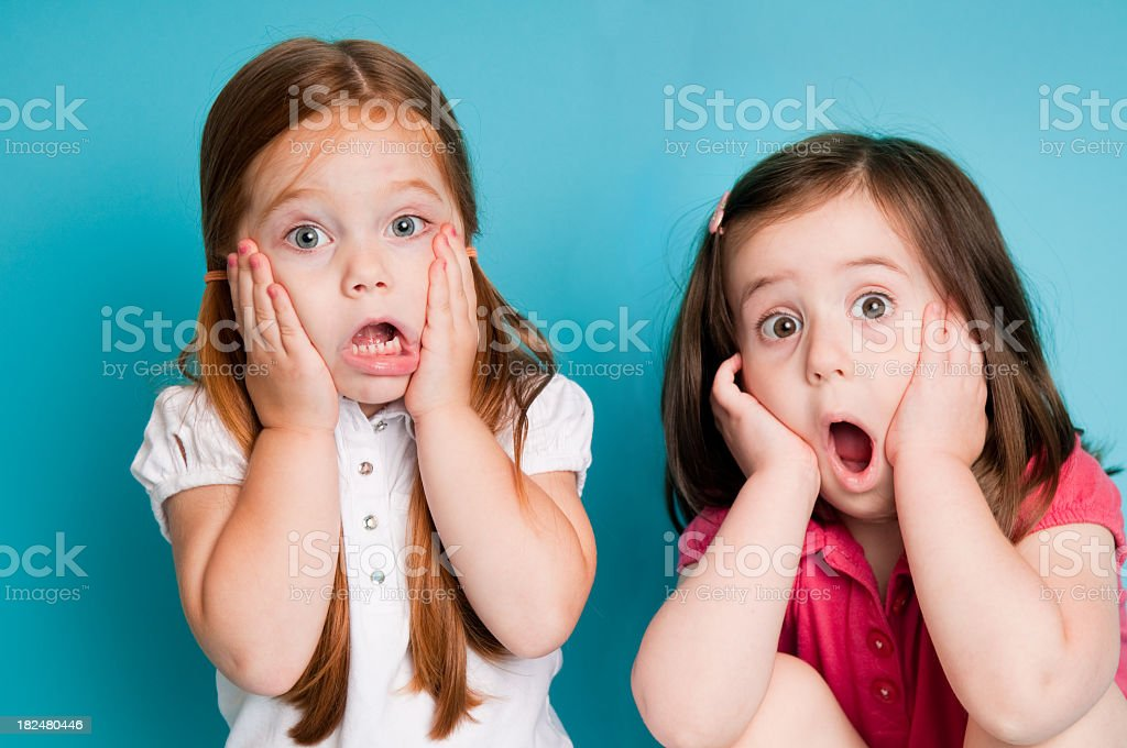 Surprised Little Girls with Looks of Shock stock photo