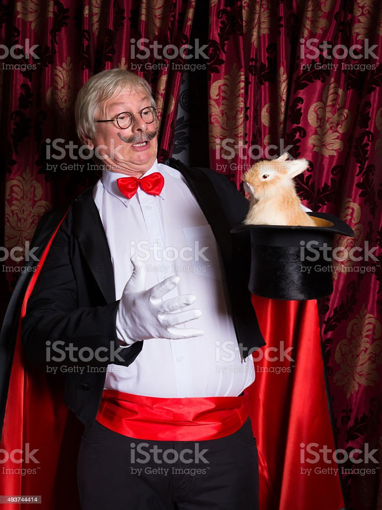 Surprised magician with rabbit stock photo