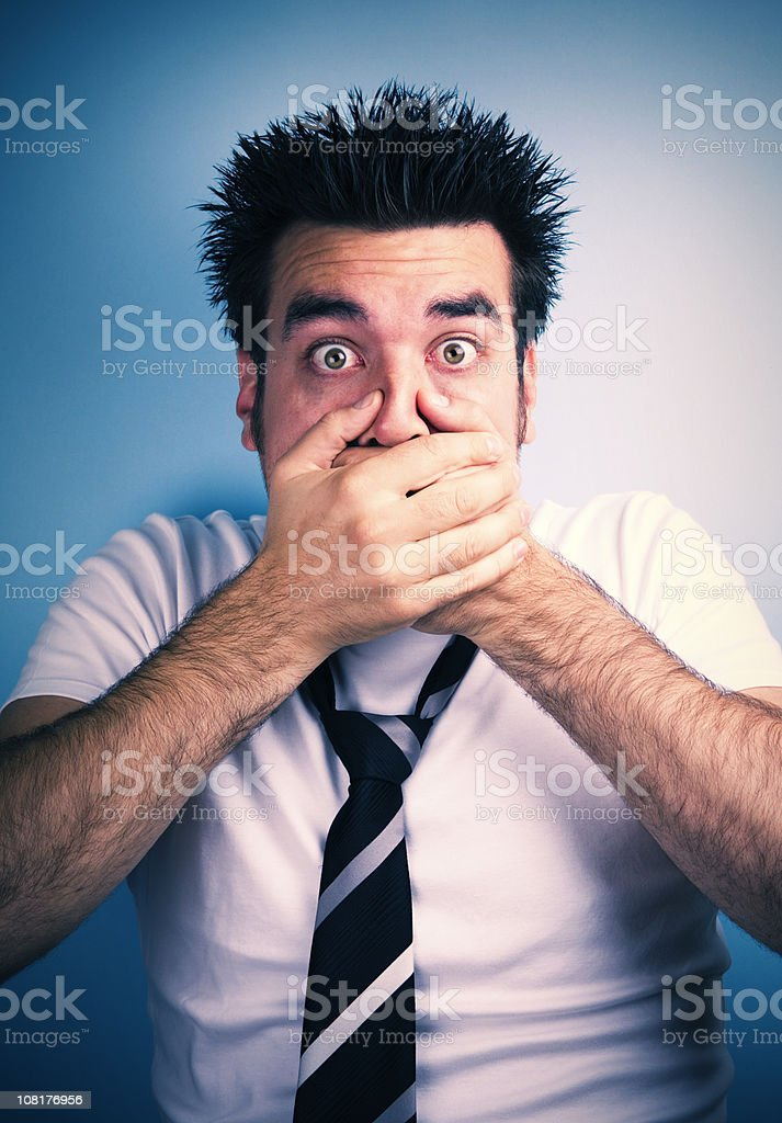 Surprised Man Covering Mouth with Hands royalty-free stock photo