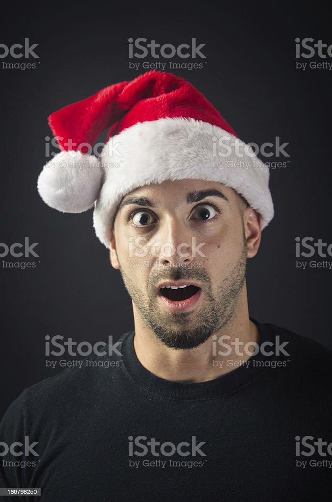 Surprised man in Santa hat royalty-free stock photo