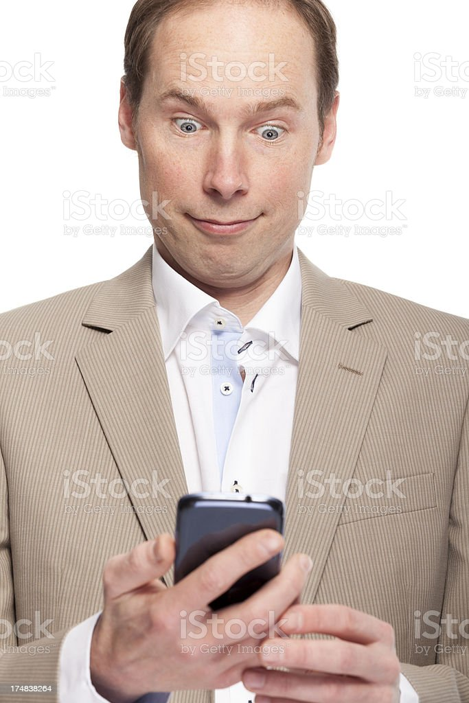 Surprised man looking at his smart phone royalty-free stock photo