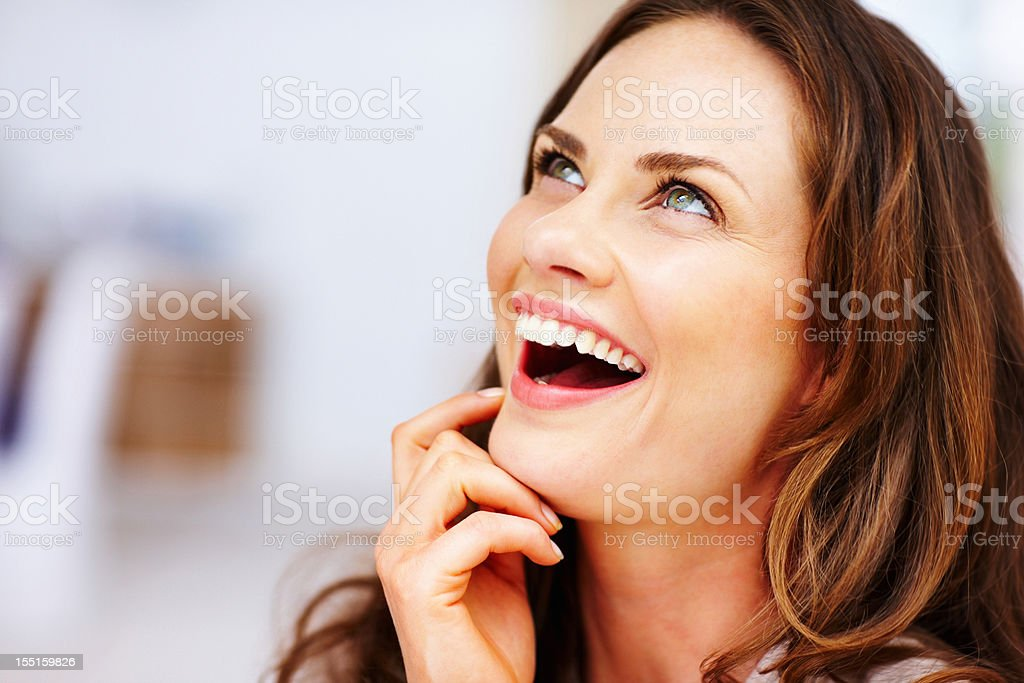 Surprised middle-aged woman looking up royalty-free stock photo