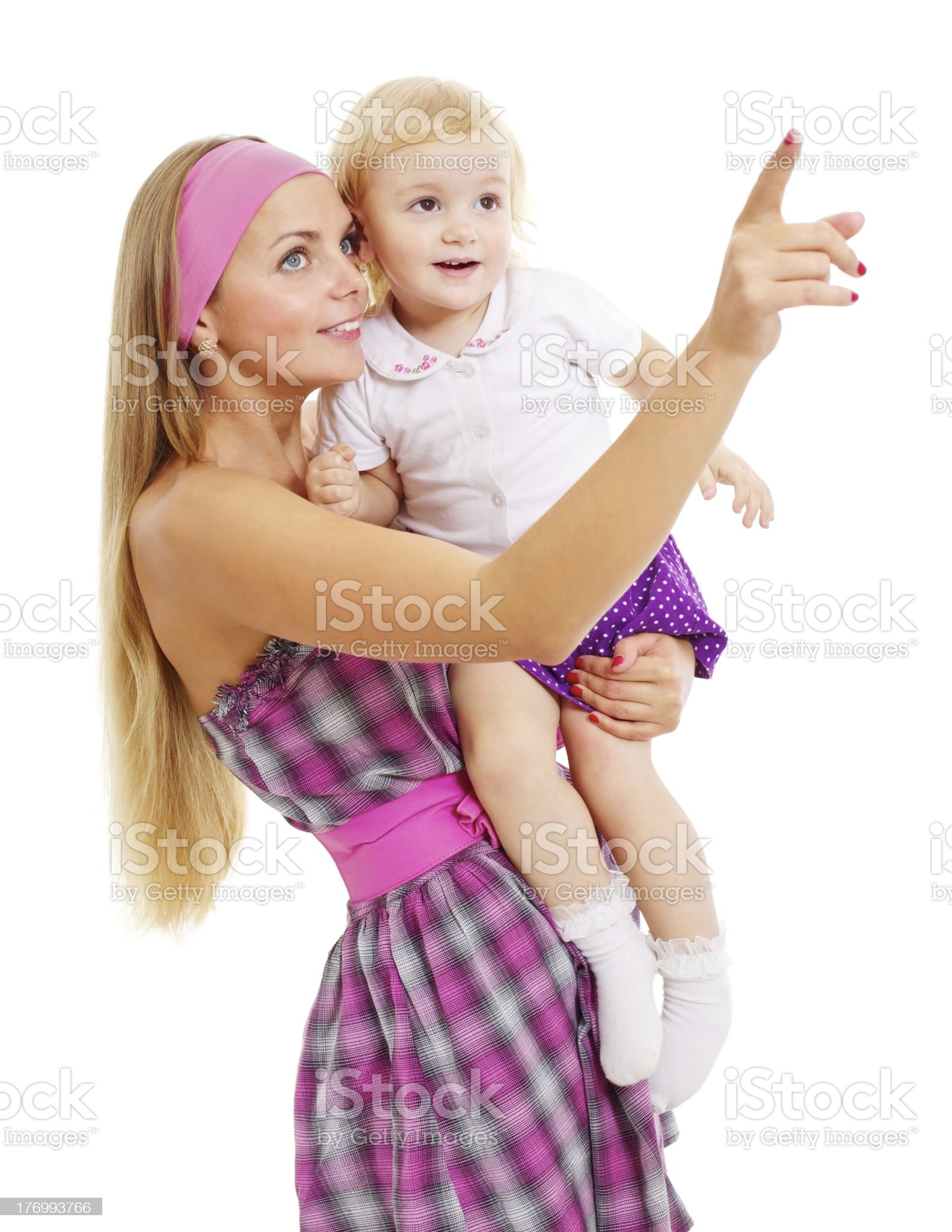 Surprised mother and baby looking ahead royalty-free stock photo