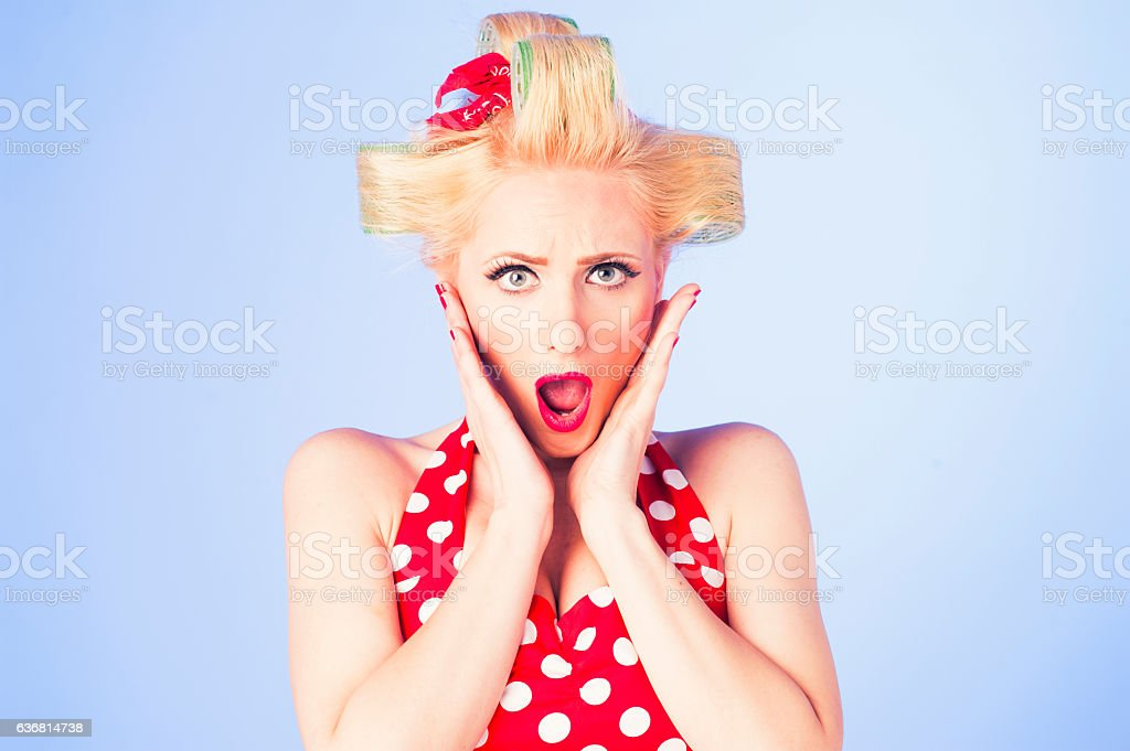 Surprised pin up girl stock photo