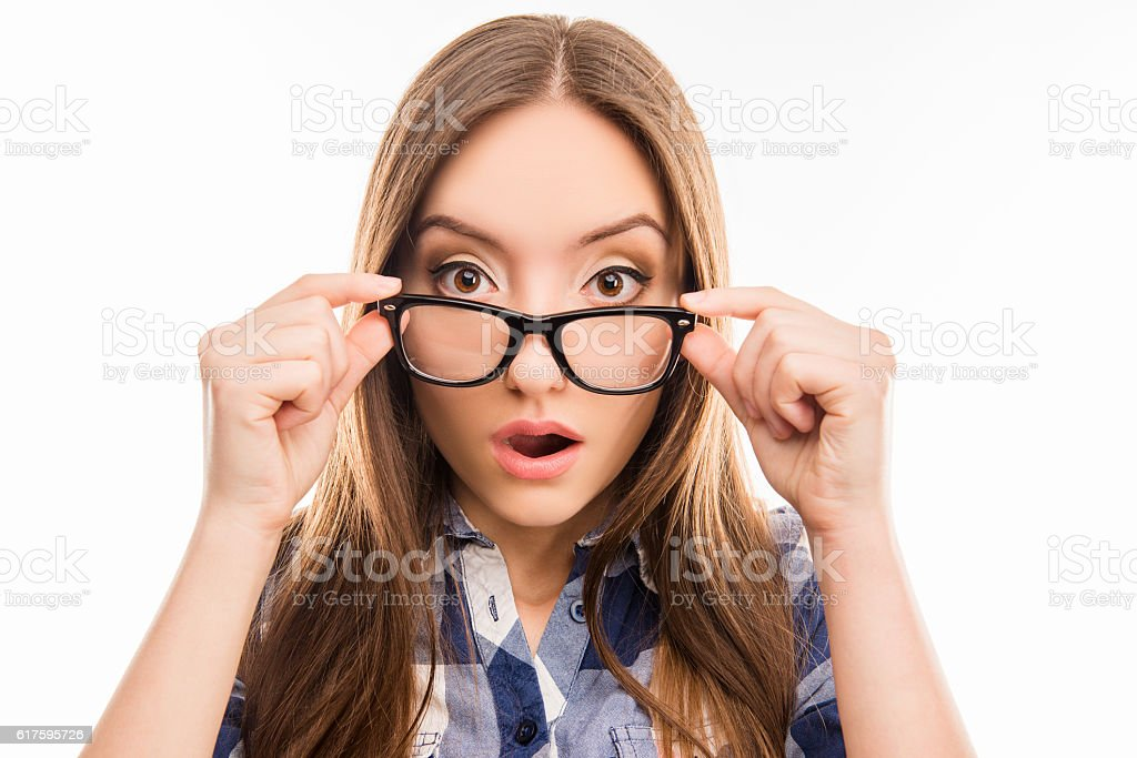 Surprised pretty  girl taking off her glasses, close up photo stock photo