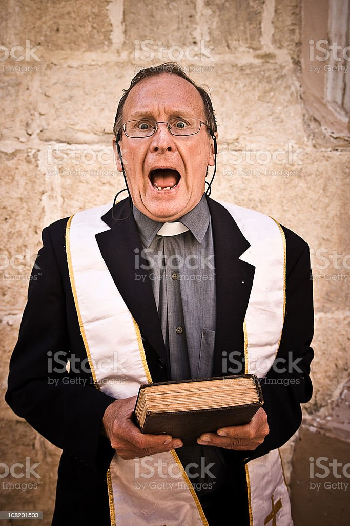 Surprised Priest Looking at Camera royalty-free stock photo