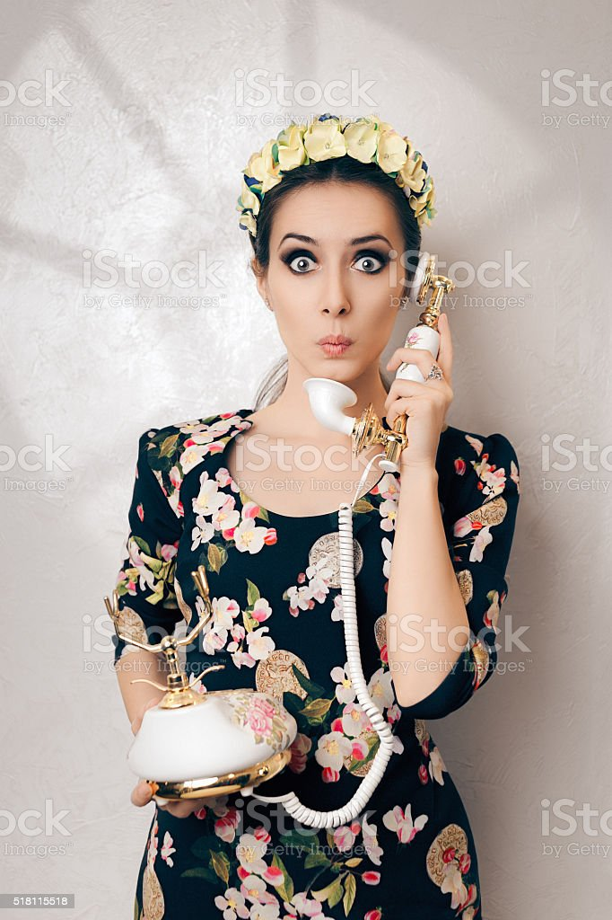 Surprised Retro Woman With Vintage Phone stock photo