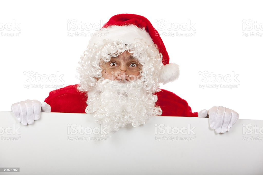 Surprised Santa Claus with Christmas advertisment sign board royalty-free stock photo