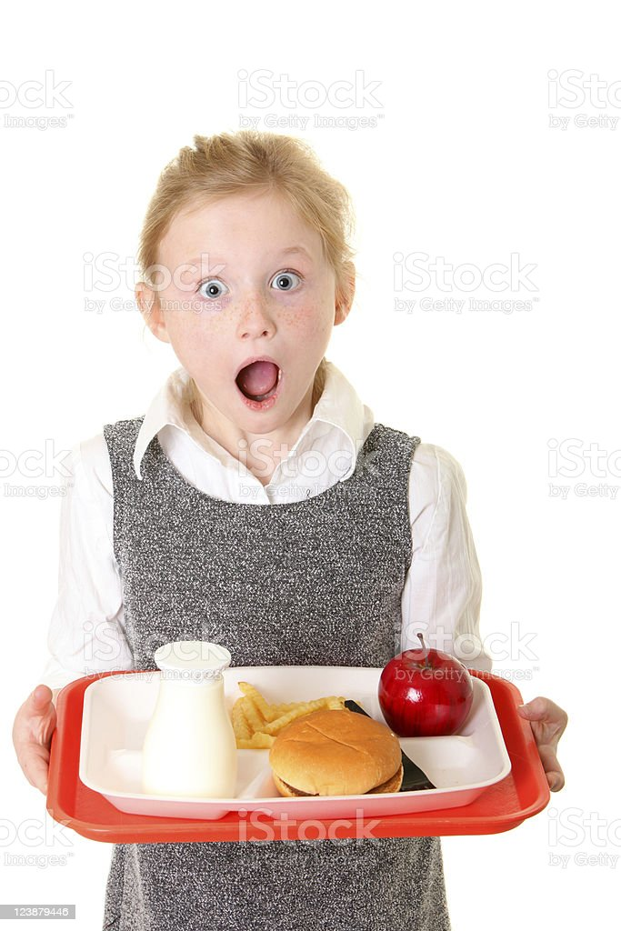 surprised school girl with lunch royalty-free stock photo