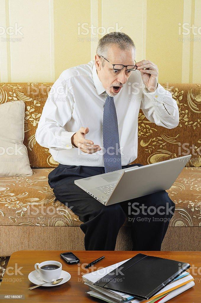 Surprised Senior Businessman with Computer stock photo