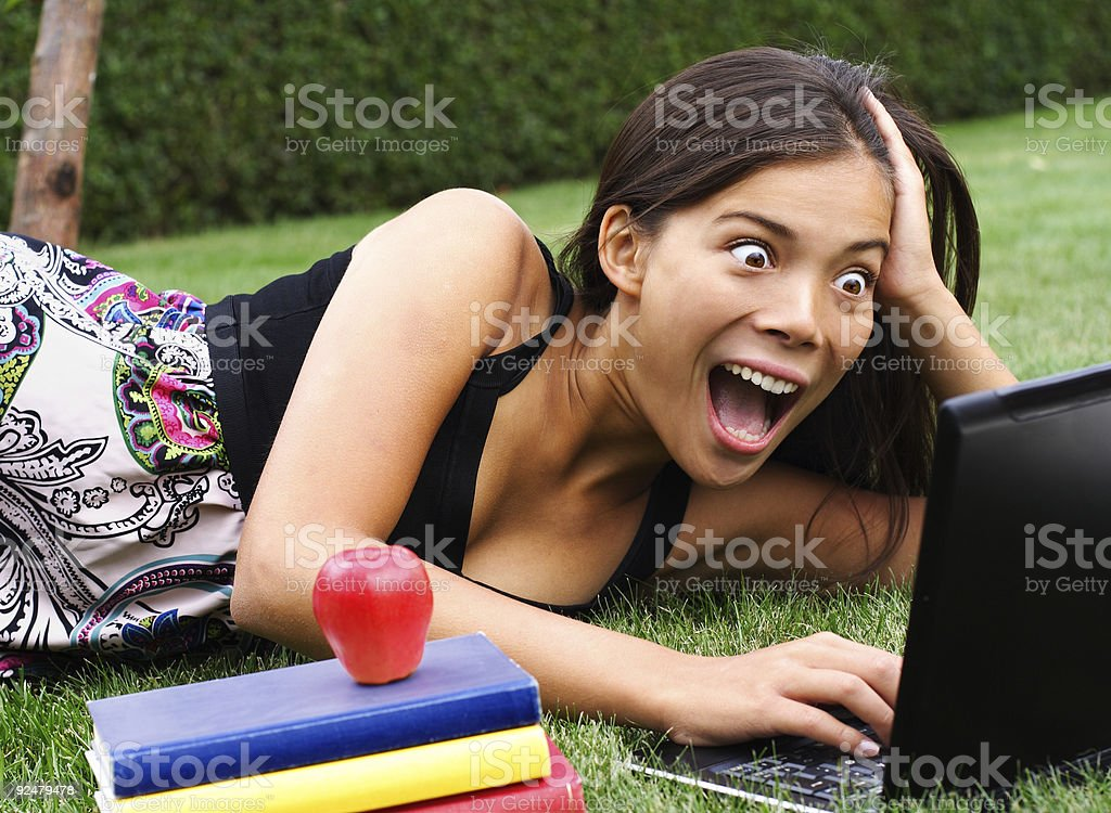 surprised student on laptop royalty-free stock photo