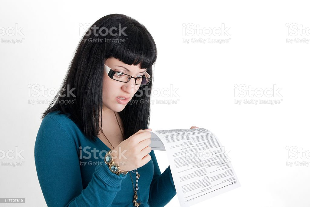 Surprised while reading the small print stock photo