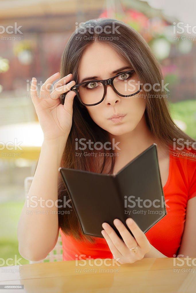 Surprised  Woman Checking Restaurant Bill stock photo