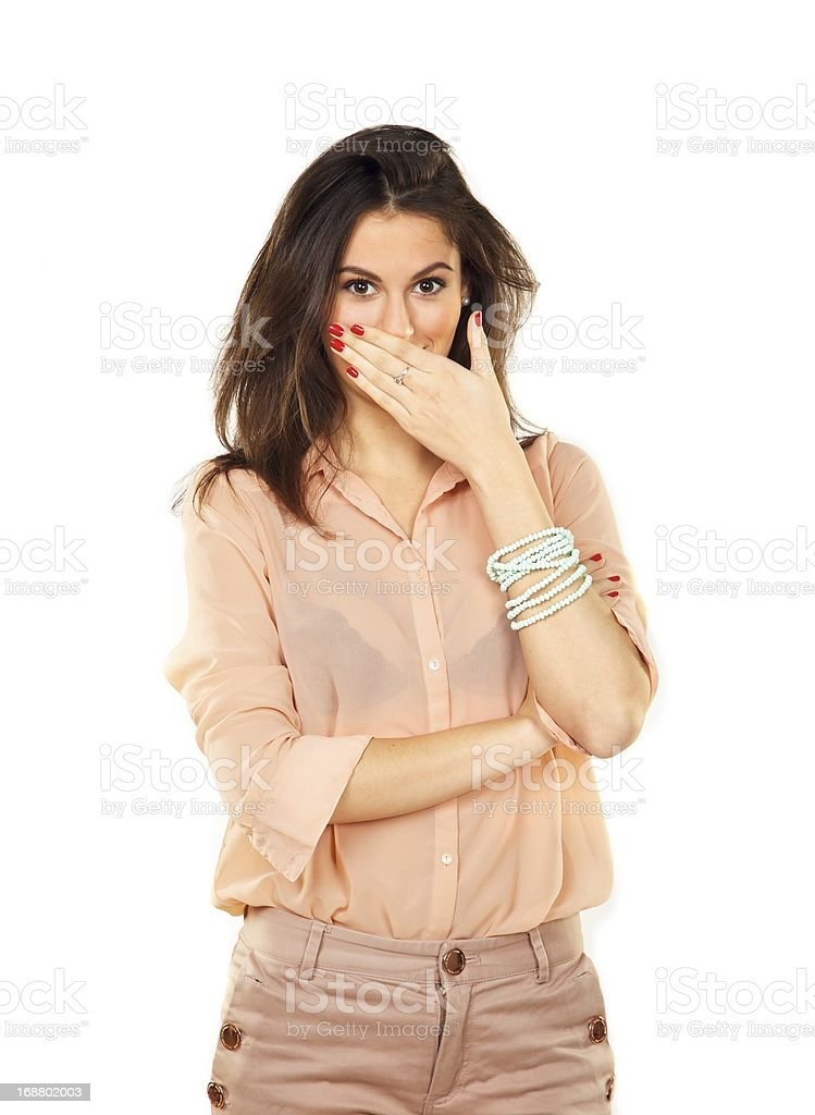 Surprised woman covering her mouth with her hands stock photo
