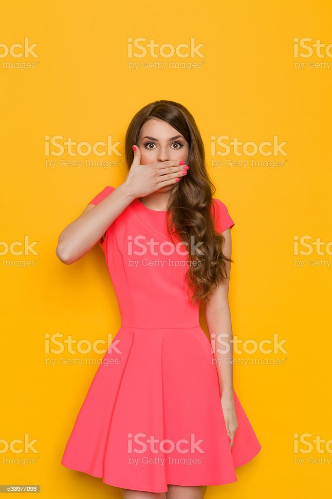 Surprised Woman Covers Her Mouth stock photo