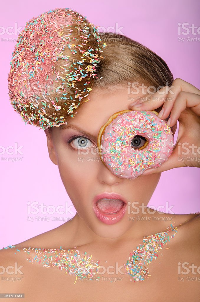 surprised woman, donut on head and front of eye stock photo