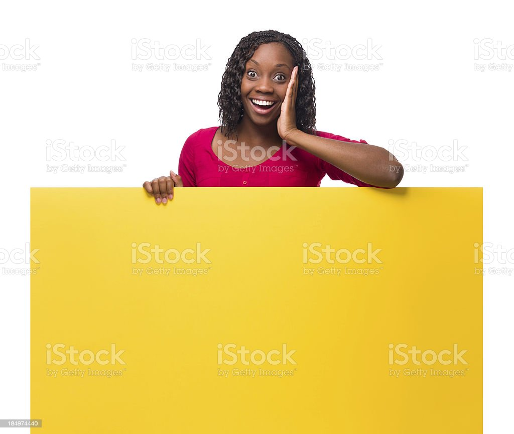 Surprised woman holding a sign royalty-free stock photo