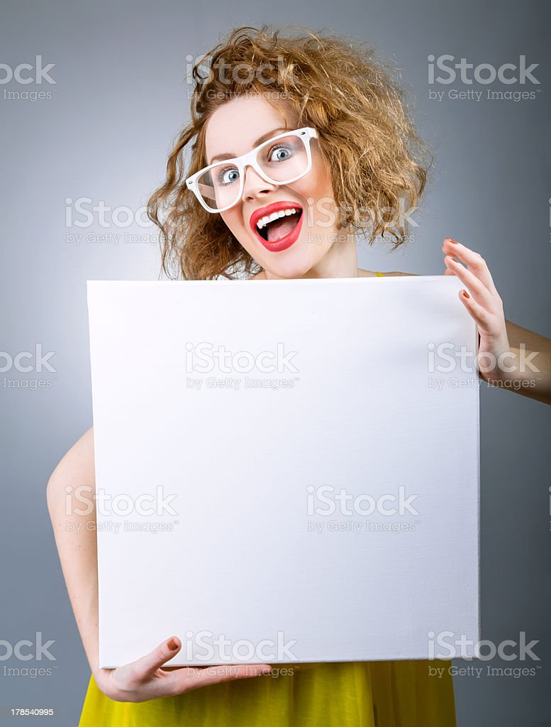 Surprised woman holding white board royalty-free stock photo
