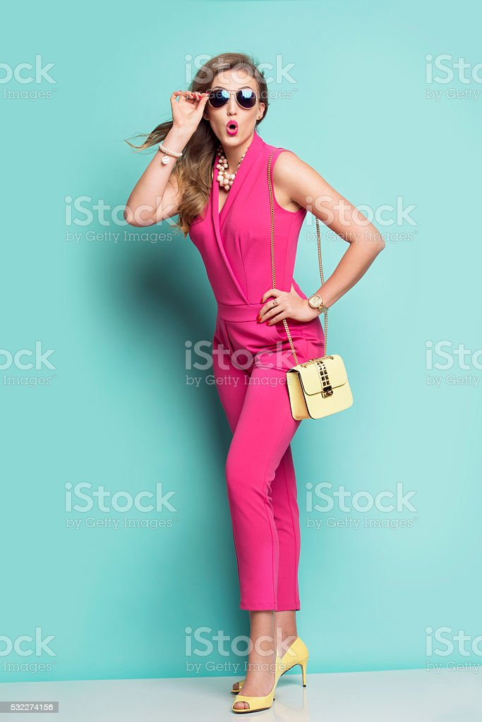 Surprised woman in a pink outfit stock photo