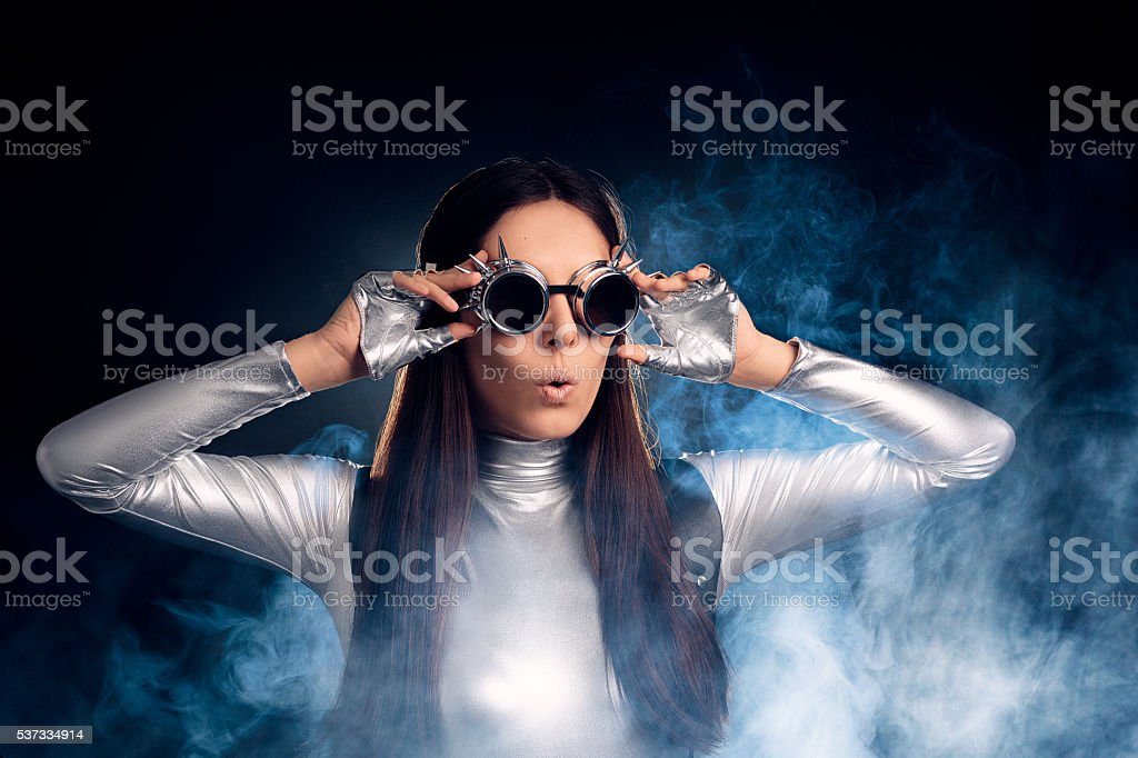 Surprised Woman in Silver Costume and Steampunk Glasses stock photo