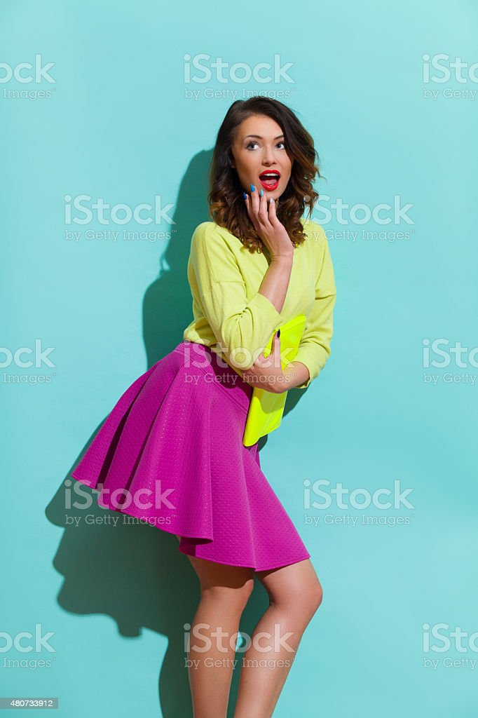 Surprised Woman In Vibrant Colors stock photo