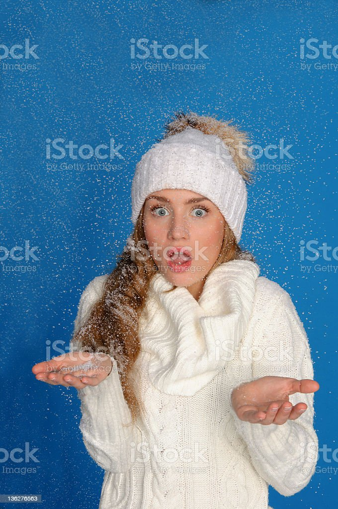 surprised woman in winter clothes under falling snow royalty-free stock photo